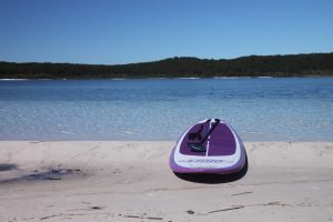 Stand Up Paddleboarding on Lake McKenzie - Fraser Island Australia