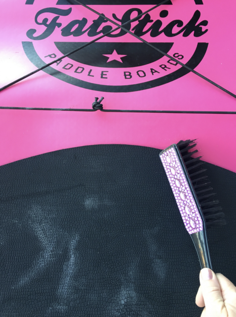 Clean your Stand Up Paddleboard by sweeping any dirt or dry leaves and grass off