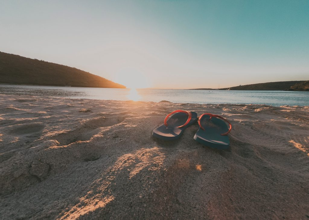 Thongs, Jandals or Flip Flops can protect your feet getting into the water to Stand Up Paddleboard