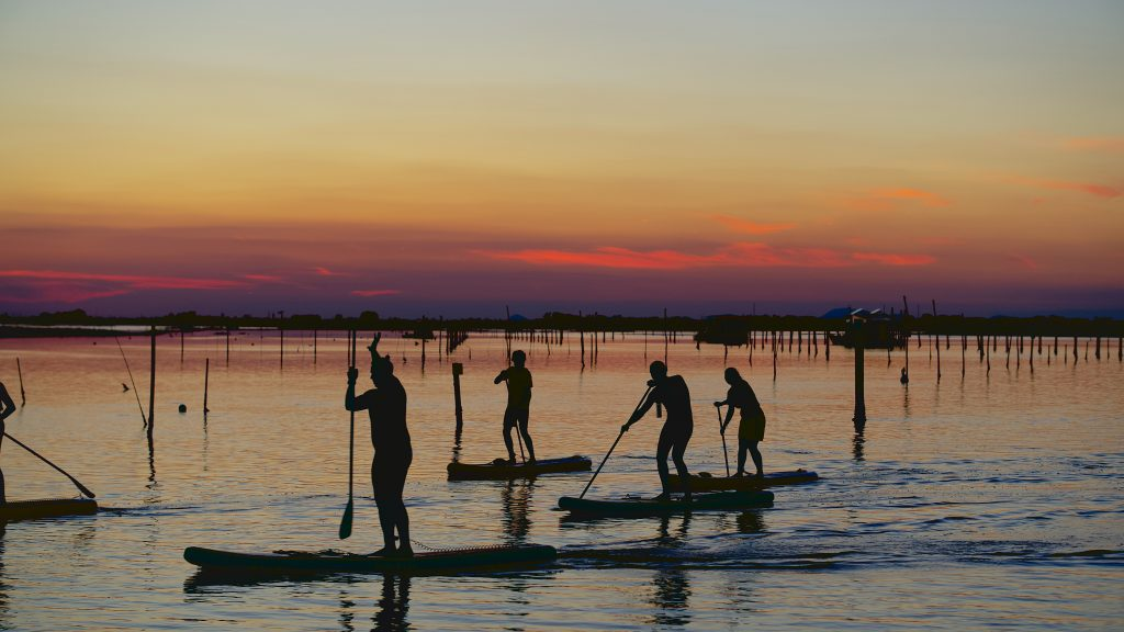 Paddling with a group can make you feel safer if you fall off your stand up paddleboard