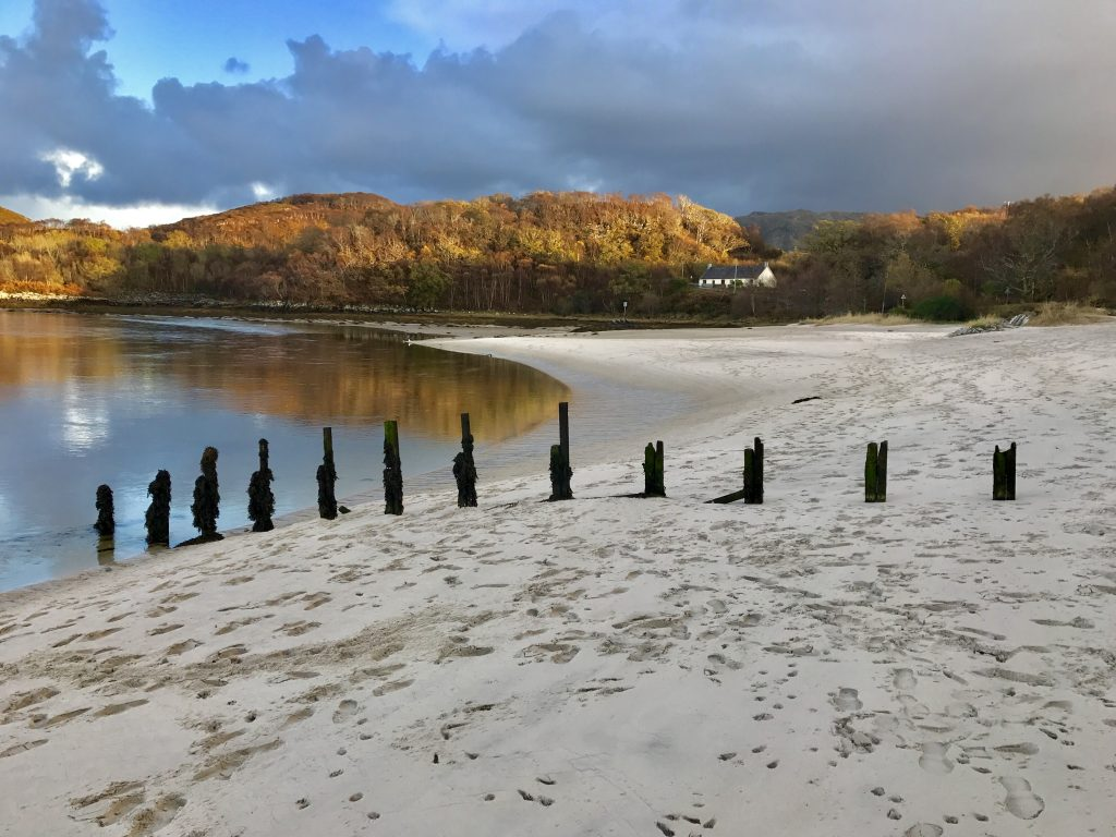 Posts on the beach at the Silver Sands of Morar