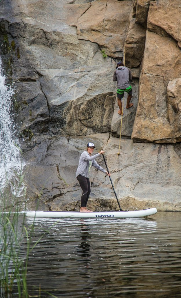 Stand Up Paddleboard and rock climber
