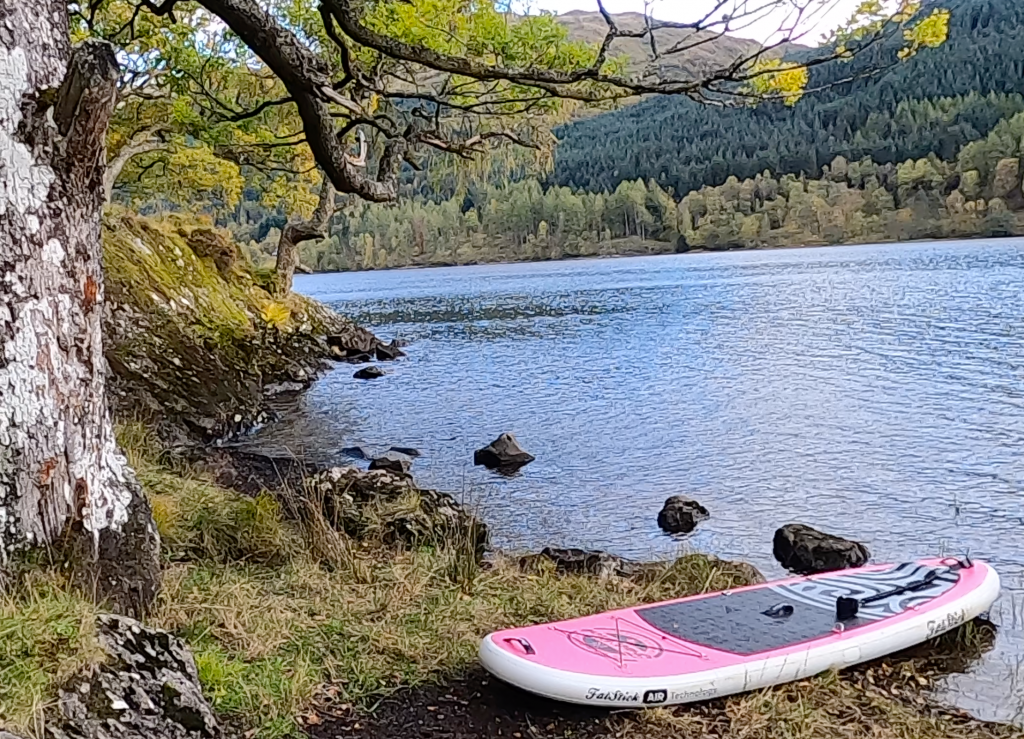 Stand Up Paddle board on Loch Voil shore