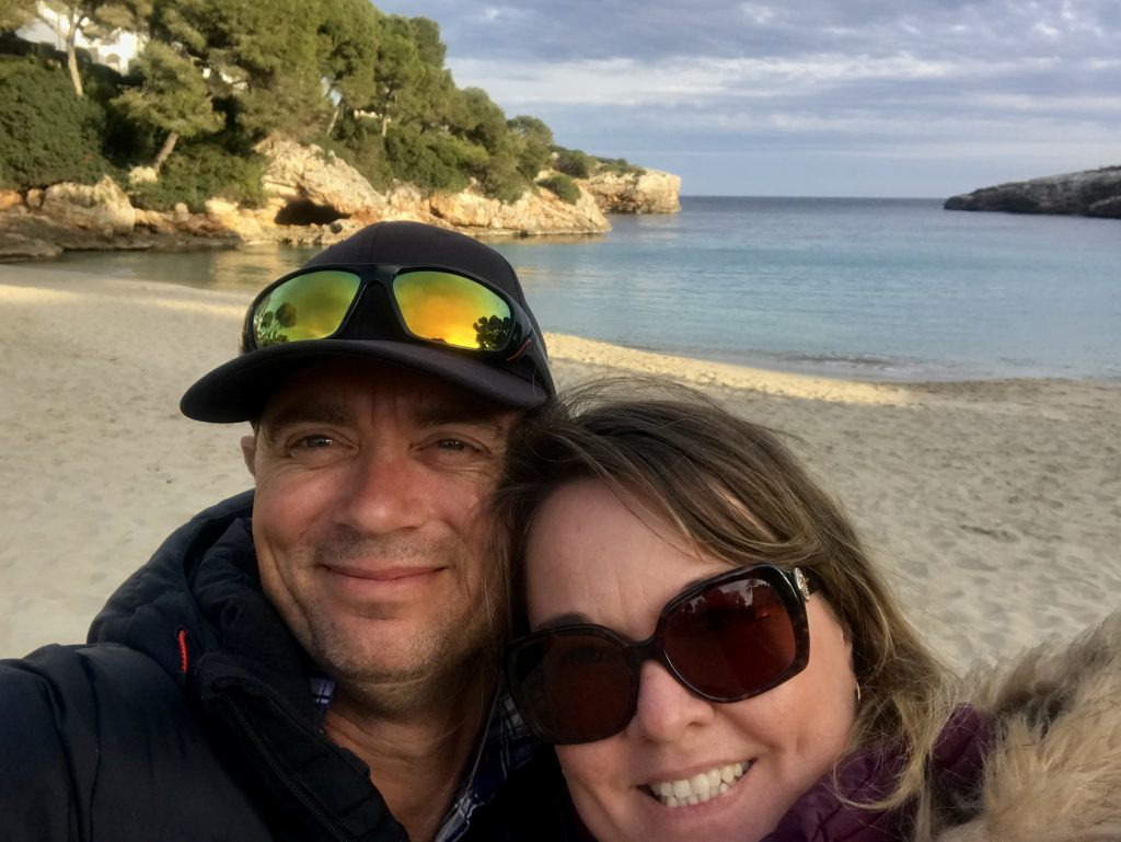 Couple on beach at Cala Esmeralda perfect for Stand Up Paddleboarding