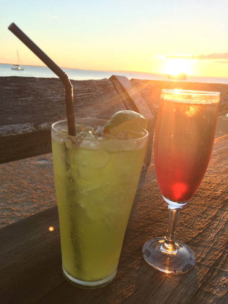 Cocktails with sun setting in the background