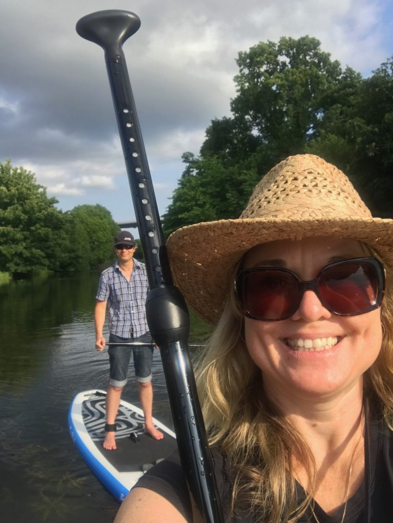Couple taking a selfie on stand up paddle boards