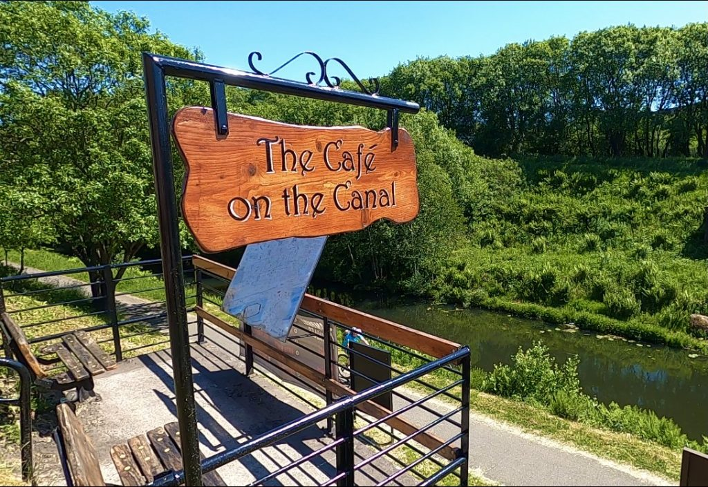 The cafe on the canal sign overlooking the Forth and Clyde Canal