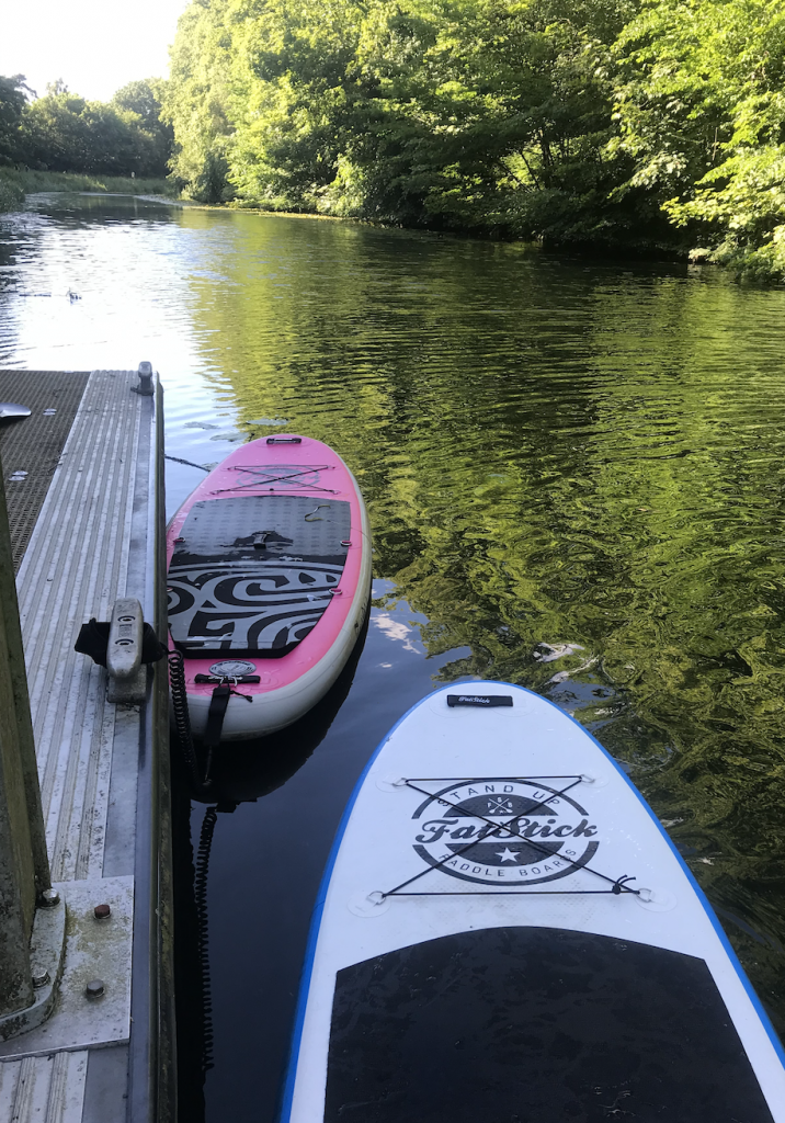 Stand Up Paddleboards ties up to pontoon on Clyde and Forth Canal