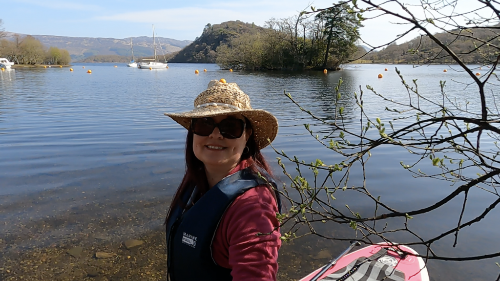 SUP Chick Selfie Stand Up Paddleboarding on Loch Lomond with boats and islands in the background