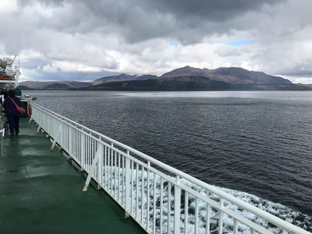 Ferry with mountains in the background