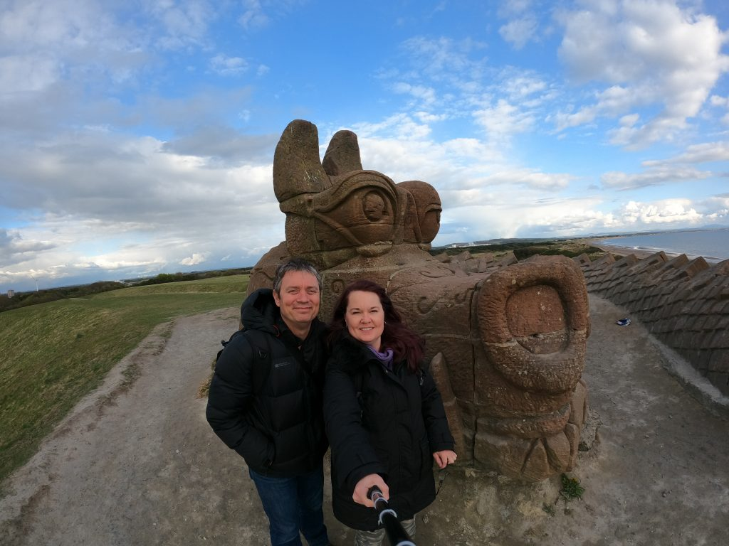 Dragon sculpture with couple in foreground