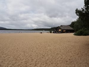 Sandy beach of Loch Morlich for Stand Up Paddleboarding