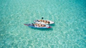 Aerial view of two women on stand up paddle boards