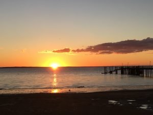 Sunset over beach and pier Fraser Island Kingfisher Bay