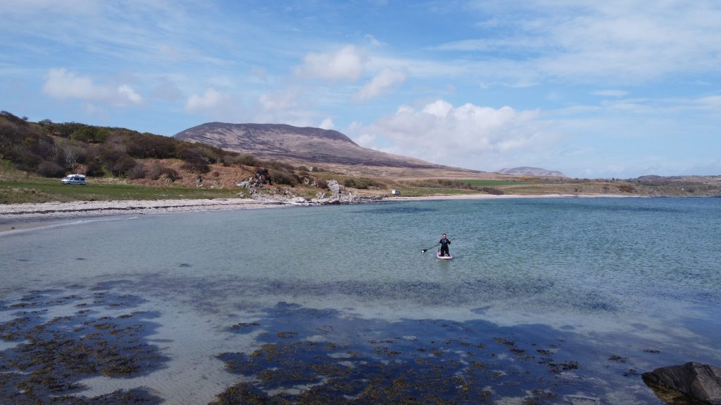 Paddleboard at beach with mountain background Islay